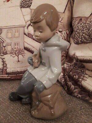 Nao Figurine Boy Sitting Holding Rabbit Figurine. • 16.99£