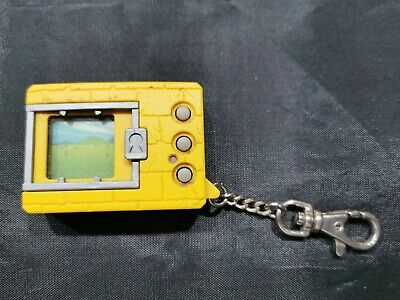 AU89 • Buy Original Bandai 1997 Digimon Japanese Yellow Tamagotchi - Good Cond