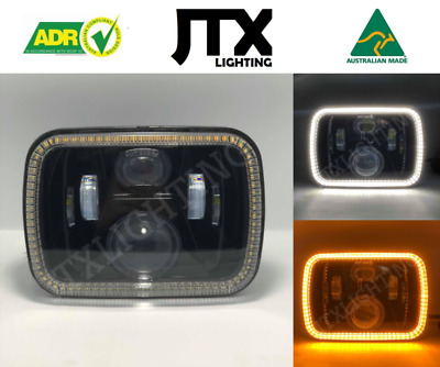 AU375 • Buy 1 Pair, Black LED JTX Headlights, 5x7 , White Halo, Flashes Amber, Suits Hilux