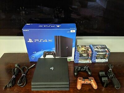 AU550 • Buy PS4 PRO 1TB Console + 18 Games + 2 Controllers And Controller Charging Station
