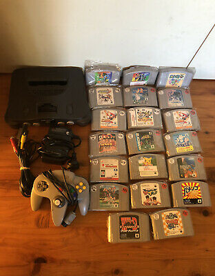 AU335 • Buy N64 Nintendo NTSC-J Console With Cords And Controller And 20 Games, Pokémon