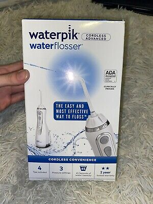 View Details Waterpik Cordless Advanced Rechargeable Water Flosser W/ Four Tips White WP560CD • 44.99$