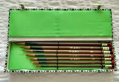 A Set Of Seven Chinese Hero Calligraphy Brushes In A Silk Covered Box VGC • 10£
