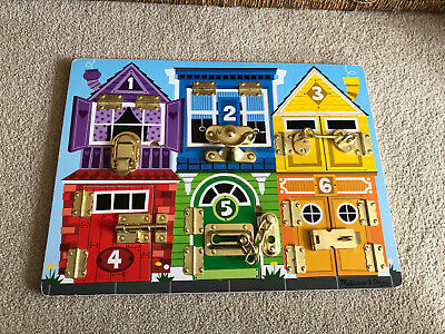 Melissa & Doug Latches Board • 7£