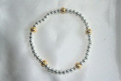 Silver Plated Stretch Bracelet With Gold Plated Accent Beads • 3.30£