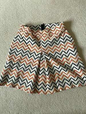 £4 • Buy Ladies White Skater Skirt With Orange And Blue Zigzag Pattern. Size 6