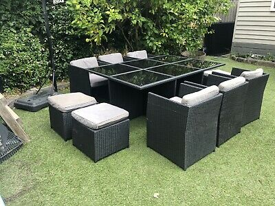 AU338 • Buy 11 Piece Outdoor Setting Grey Rattan; Used; Glass Top;