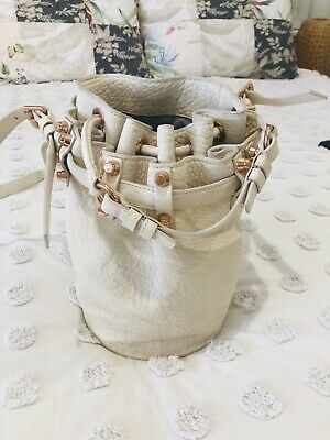 AU200 • Buy Alexander Wang Diego Bucket Bag In Pebbled Opaline With Rose Gold