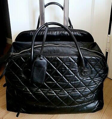 Chanel Two Wheel Quilted Leather Trolley Travel Bag • 1,573.56£