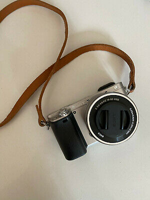 $ CDN550 • Buy Sony Alpha A6000 With 16-50mm Lens In Silver With Tan Leather Strap