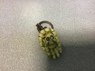 £2.50 • Buy Skull In A Hand Keyring With Green Eyes