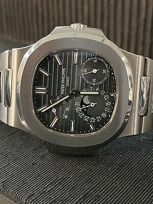 £86962.35 • Buy Patek Philippe 5712 Nautilus Stainless Steel Mens Watch Box/Papers 5712/1A-001