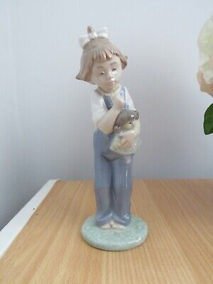 Nao  Figurine  Girl Wearing Dungarees Clutching  Doll   • 5£