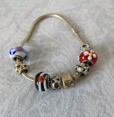 £4 • Buy Charm Braclet With 7 Charms