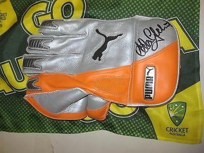 AU399 • Buy Adam Gilchrist (Australia) Signed Puma Wicketkeeping Glove (Orange/Silver) + COA