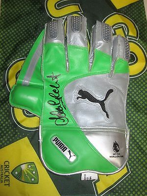 AU399 • Buy Adam Gilchrist (Australia) Signed Puma Wicketkeeping Glove (Green/Silver) + COA