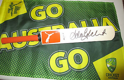 AU175 • Buy Adam Gilchrist (Australia) Signed Orange Puma Mini Bat + COA & Photo Proof