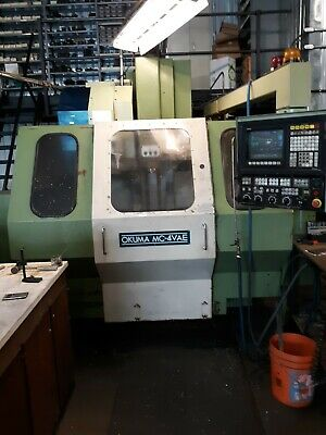 $5000 • Buy OKUMA MC-4VAE VERTICAL MILLING MACHINE With FORTH AXIS
