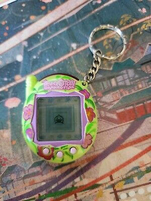 $ CDN100 • Buy Tamagotchi Connection V3 Green Purple Hibiscus Flower Tested & Works
