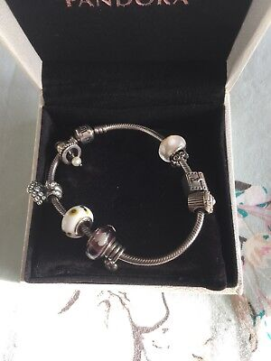 Pandora Braclet With Nine Charms  • 99.99£