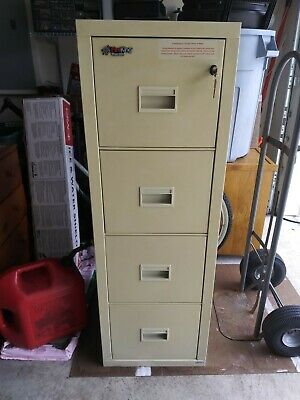 Four Drawer Beige / Tan Fire Proof Office Filing File Cabinet 2 Keys Used • 300$