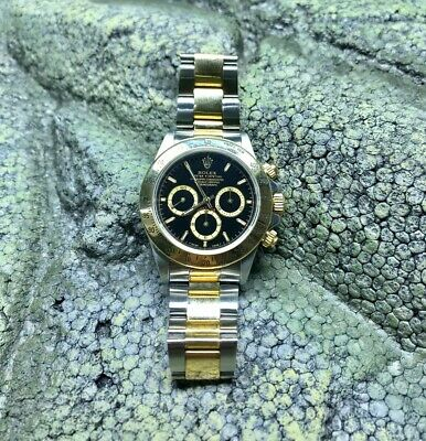 $ CDN21111.01 • Buy Rolexs Daytona 16523 Zeniths 2Tone 18K Yellow Gold/SS Black Dial Watch Box Paper