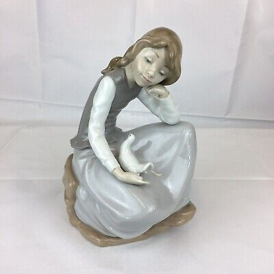 Nao By Lladro Figure Girl With Dove Sitting On A Rock 23.5cm In Height • 39£
