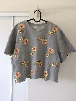 AU11 • Buy Urban Outfitters Floral Embroidered Short Sleeve Sweatshirt Grey Jumper M