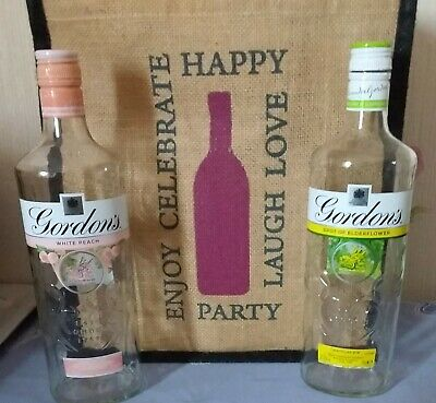 2 Empty Gordons  Gin Bottles 70cl, 1x White  Peach &  1 X A Spot Of Elderflower • 0.99£