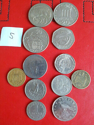 A Mix Of Old Foreign Coins • 1£