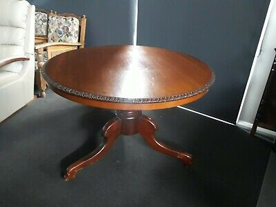 AU750 • Buy Antique Cedar Round Table With Carved Edging.