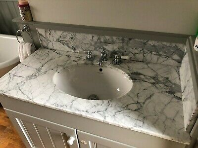 Bathroom Sink With Quartz Marble Counter Top And Fired Earth Taps • 10.50£