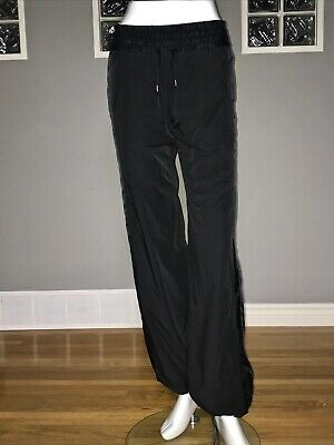 $ CDN75 • Buy LULULEMON RIGHT ROUND PANT 2 TALL BLACK TRACK PANT EEUC GLYDE DWR To And From