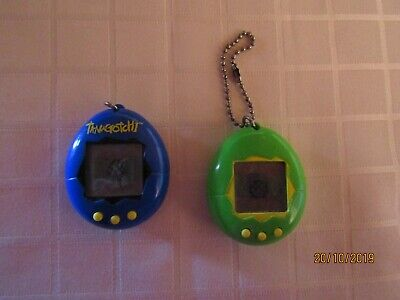AU179 • Buy Tamagotchi's 1997 Bandai Blue With Yellow Buttons And Green With Yellow Buttons