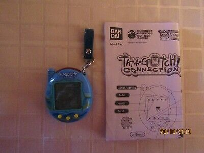 AU79.90 • Buy Tamagotchi Bandai Blue With Yellow Buttons