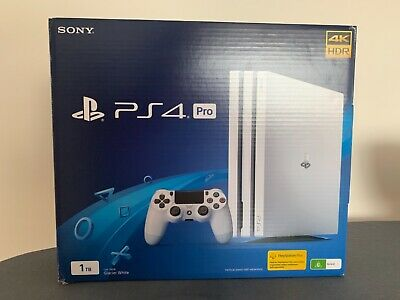 AU500 • Buy Used White PS4 Pro 1TB, 2 Controllers Included, 4 Games, Dual Charging Dock