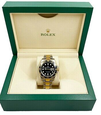 $ CDN14158 • Buy Rolex GMT Master II 116713 Black Ceramic 18K Yellow Gold Stainless Steel