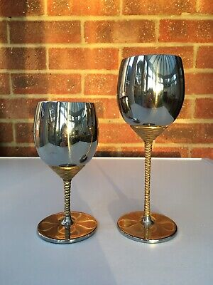 A Viners Stuart Devlin Stainless Steel Wine And Matching Water Goblet, 1970s. • 15£