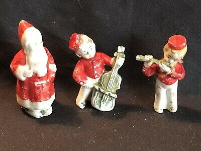 £35 • Buy Three Bisque  Figures Including Two Child Musicians And  Father Christmas