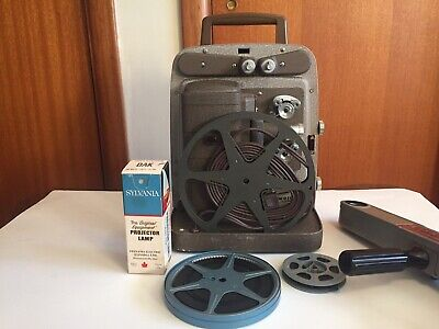 $ CDN95 • Buy Bell And Howell 8mm Projector With Spare Bulb And Extras