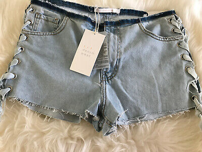 ZARA TRAFALUC DENIM SHORTS With Lace Up Sides • 13£