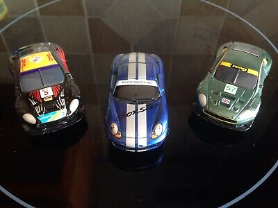 MICRO SCALEXTRIC CARS X 3 ASTON MARTINS AND PORSCHE GOOD RUNNERS • 9.95£