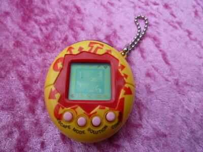 AU25 • Buy  Tamagotchi  Device Yellow And Red