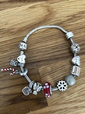 Pandora Bracelet With Lots Of Charms • 29£