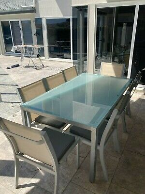 AU99 • Buy Outdoor Dining Set - Large Glass Table And 8 Chairs With Cushions. Downsizing.