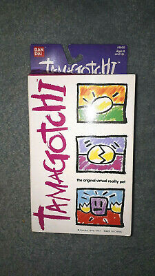 AU50 • Buy Tamagotchi 1997 Green With Yellow Buttons - Original Box