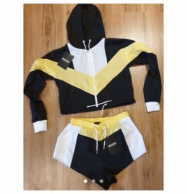 Shell Suit- Black And Yellow Short Sell Suit • 15£