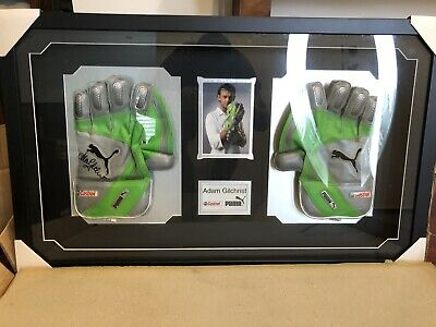 AU499 • Buy Limited Edition Adam Gilchrist Autographed And Framed Wicketkeeping Gloves Puma