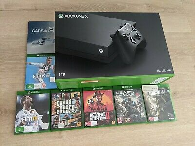 AU375 • Buy Microsoft Xbox One X 1TB Black + 7 Games