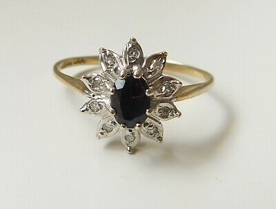 A 9ct GOLD DIAMOND AND SAPPHIRE STONE SET RING • 85£